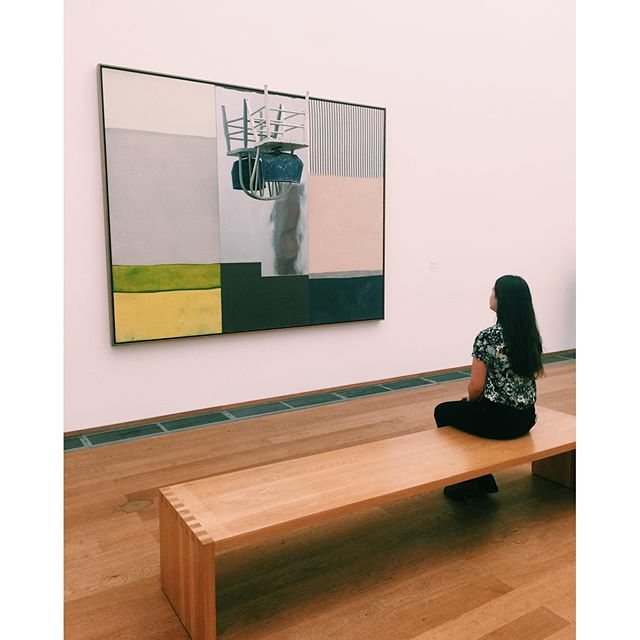 My little sister looking at art